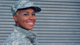 Female Veterans smiling into the camera