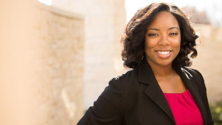 Confident, smiling black business woman looking ready for a CEO role
