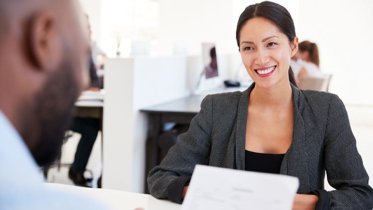 Asian business women conducting informational interview with a black business executive