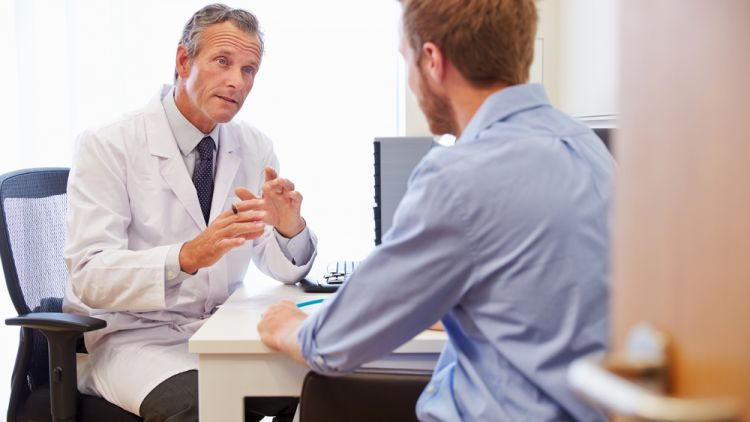 doctor and healthcare professional talking to patient about innovative solutions