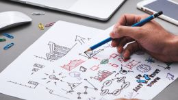 man sketching an idea on a piece of paper