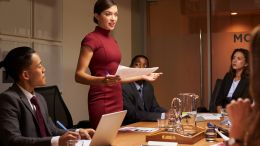 business woman in meeting room leading discussion on innovation and change management