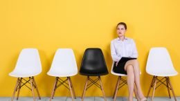 Woman sitting in waiting room waiting for recruiter interview