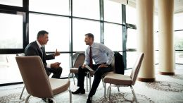 two men discussion in the lounge, using trust to build a persuasive relationship