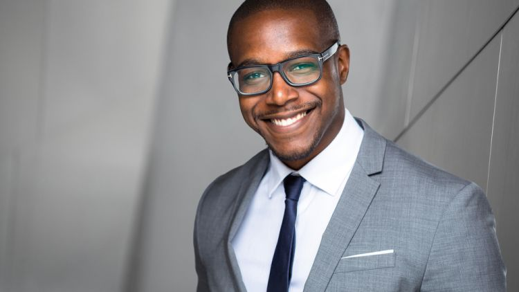 Successful black professional man with characteristics of a leader