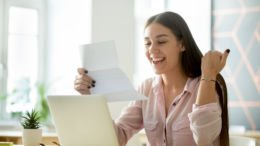 woman excited reading letter