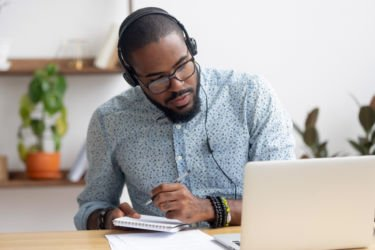 man on headphones working at home