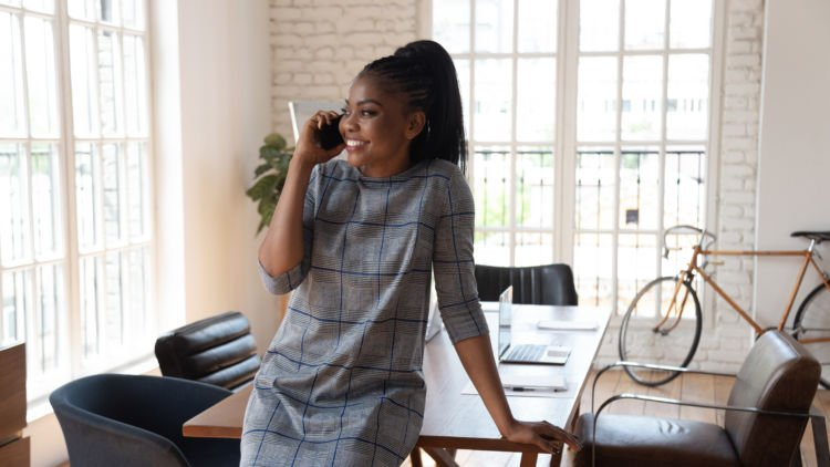 woman negotiates job offer over the phone