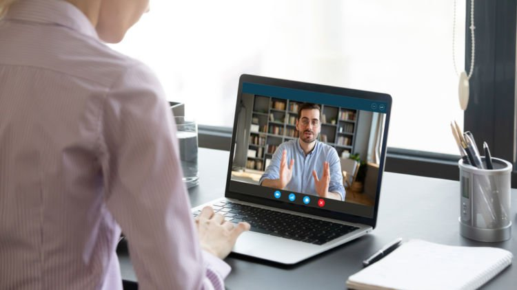 an employee receives notification of a pay cut over a video conference