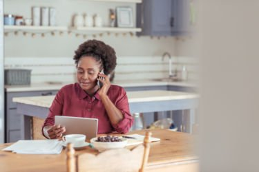 Black professional at her kitchen table deciding how to change careers
