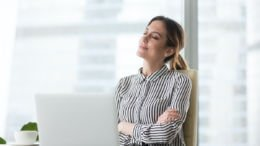 Executive woman practicing mindfulness at work
