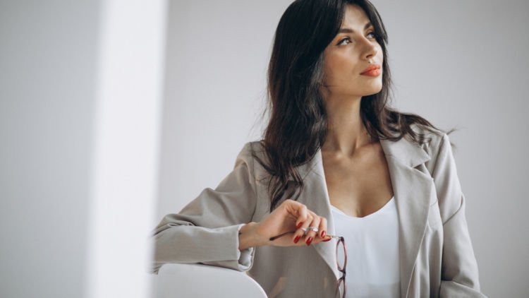 Business woman looks thoughtful and positive while she considers a career change
