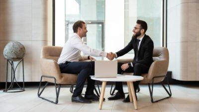 Two businessmen meet for a job interview