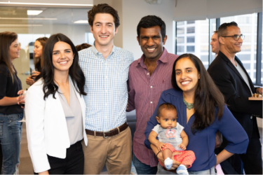 From left to right, Keystone Next member Jessica Solomon, Keystone consultant Bennett Winton, and Keystone Next members Kadir Annamalai and Neha Bhargava with their daughter at an event in the San Francisco office.